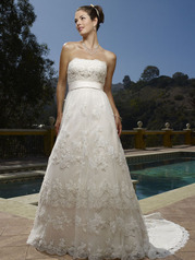 The beaded (Chantilly) lace overlay scallops on the neckline with elaborate hand
