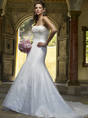 Glamorous trumpet shaped silhouette adorning pearl and sequined lace appliques. 