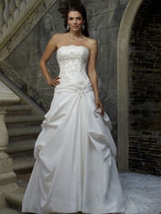 Strapless bodice crowned with a scalloped neckline is radiantly ornamented with 