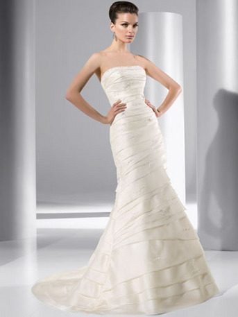 Demetrios. An upcharge of $100 applies to sizes 18-20. An upcharge of $150 appli